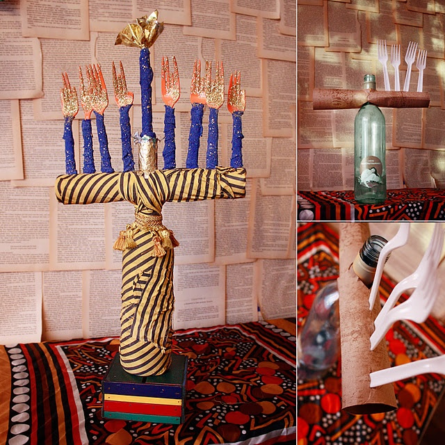 Kid Craft menorah made from a wine bottle and cardboard tube.