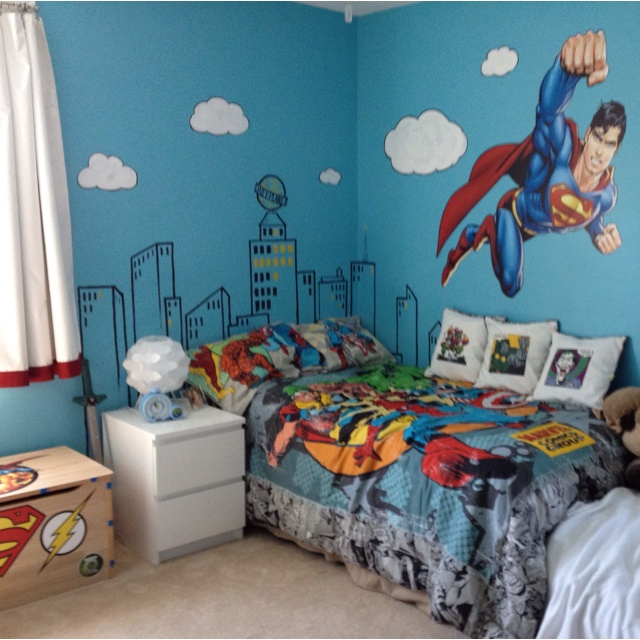 A superhero room complete with Metropolis headboard and bad guy pillows to battle My boy is a happy one