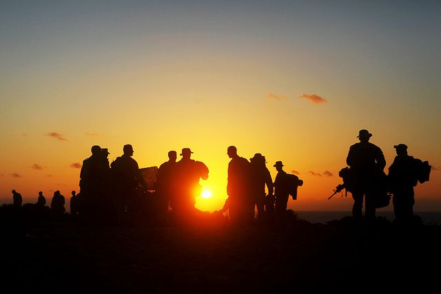 Marines with Alpha Company, Battalion Landing Team 1st Battalion, 2nd Marine Regiment, 24th Marine Expeditionary Unit, stage their gear...