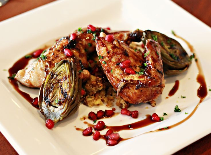 Pan Roasted Pomegranate Glazed Half Cornish Game Hen Served on pecan ...