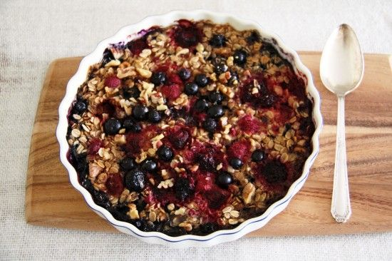 Baked oatmeal with mixed berries, banana, maple syrup and walnuts