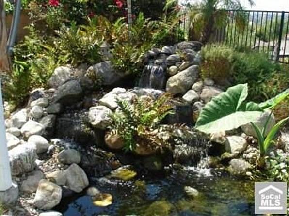 River rock pond bing images for Rock ponds designs