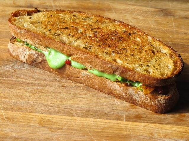 Grilled Cheese Social: Green Haze Gouda Pesto, sautéed garlic, sun ...