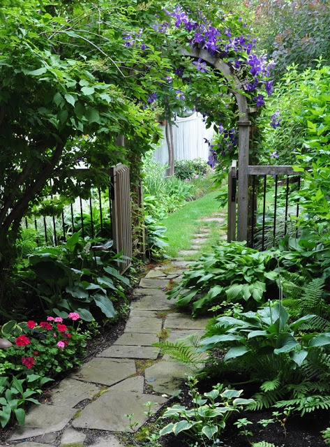 shady garden entrance outside paths stepping stones