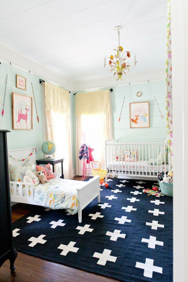 Vivi and Brigette's Home Away from Home  Nursery Tour - shared nursery room with pale green walls, printed artwork and a graphic rug