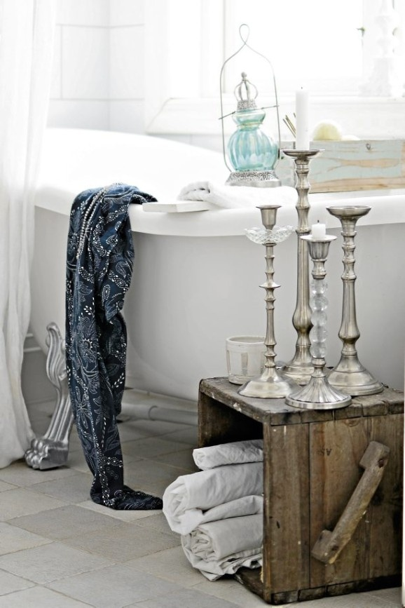 I just love clawfoot and freestanding tubs.  How about adding a wood box with candlesticks for added decor?