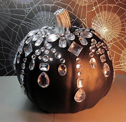 Paint pumpkin black, stem with silver. Glue on 'jewels'.  awesome