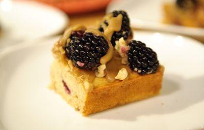 Brown sugar buttermilk cake with blackberries and caramel walnut driz ...