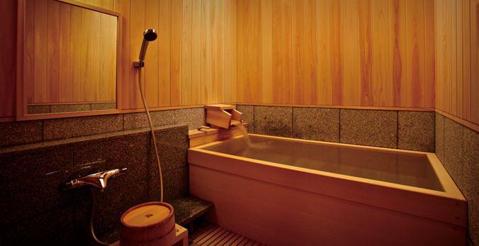 ... -paneled onsen interior.  Universal design bathroom with Japanes