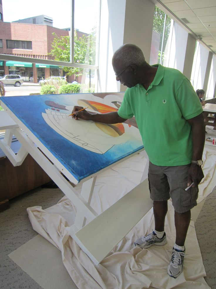 Don Blanton paints his table on Day 2.