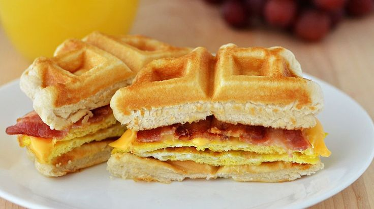 ... sandwich: bacon, eggs and cheese stacked on golden biscuit waffles