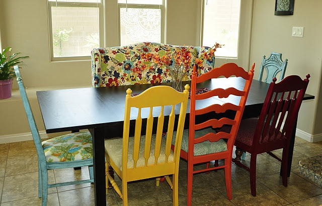 Brightly Colored Chairs As Contrast To The Dark Simple Table