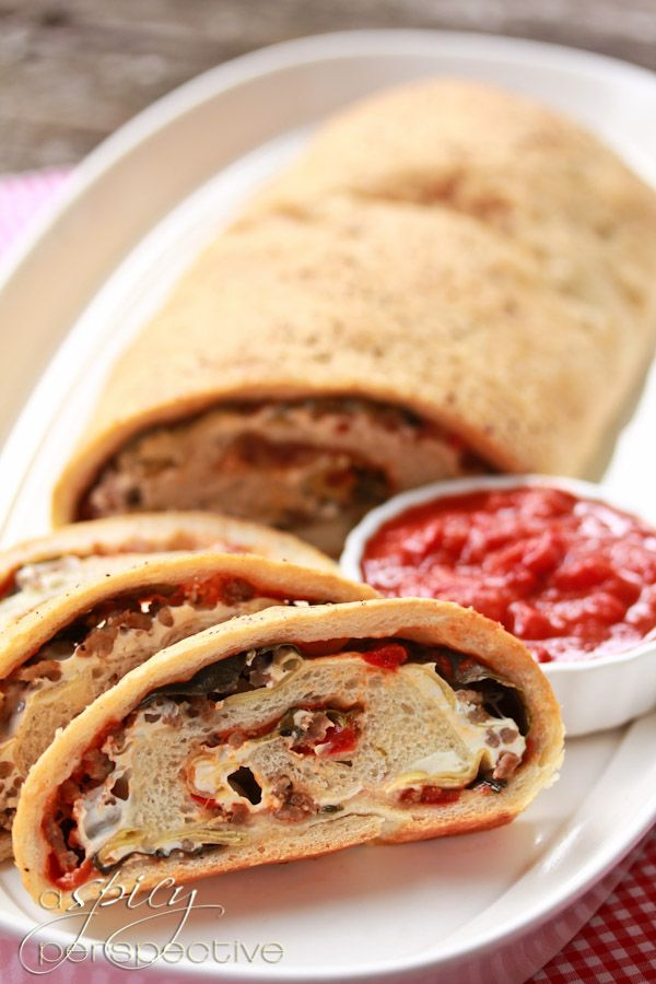 Italian Stromboli Loaf With Artichokes, Olives, Sausage, And Red ...