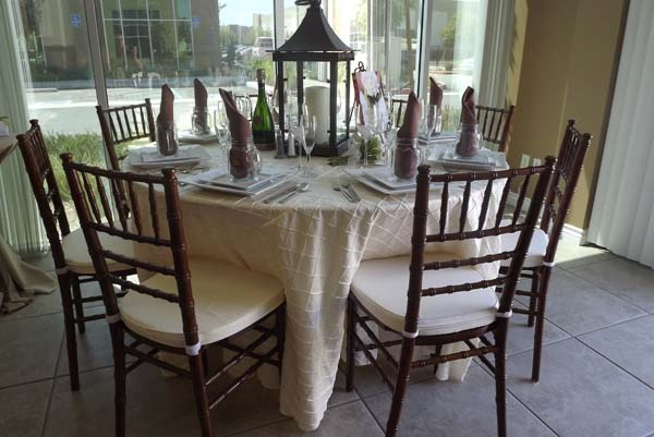 Alllie s party rental fruitwood chiavari chairs with ivory pads