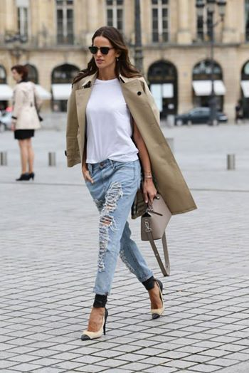 Izabel Goulart in distressed jeans, a classic trench and ISABEL MARANT pumps