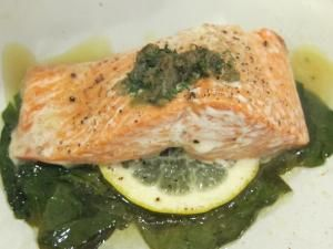 Salmon with Dill and Caper Compound Butter over Spinach in Parchment ...