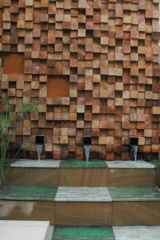 Cedar timber blocks offcuts assembled to create a wall for Outdoor feature wall ideas
