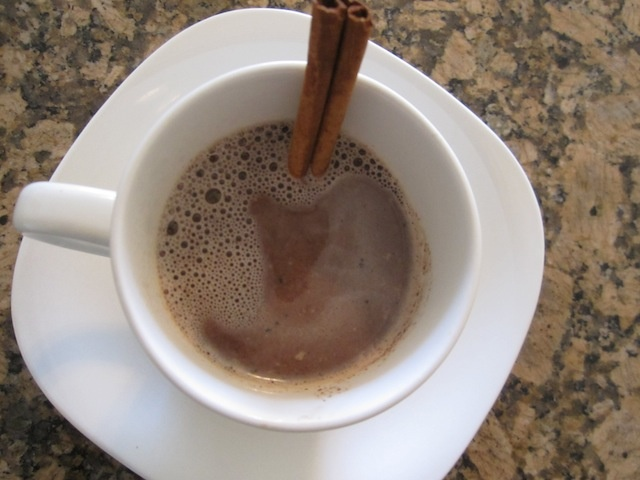 Healthier cocoa: 2 melted squares 70% dark chocolate, seeds from 1/2 of a real vanilla bean, stirred into 1 cup warm sunflower seed milk with a cinnamon stick for stirring (note: you can swap the sunflower seed milk for almond milk, hemp milk, flax milk, etc.)