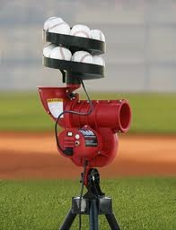 We'd have a small pitching machine so the kids (big and little) could play.
