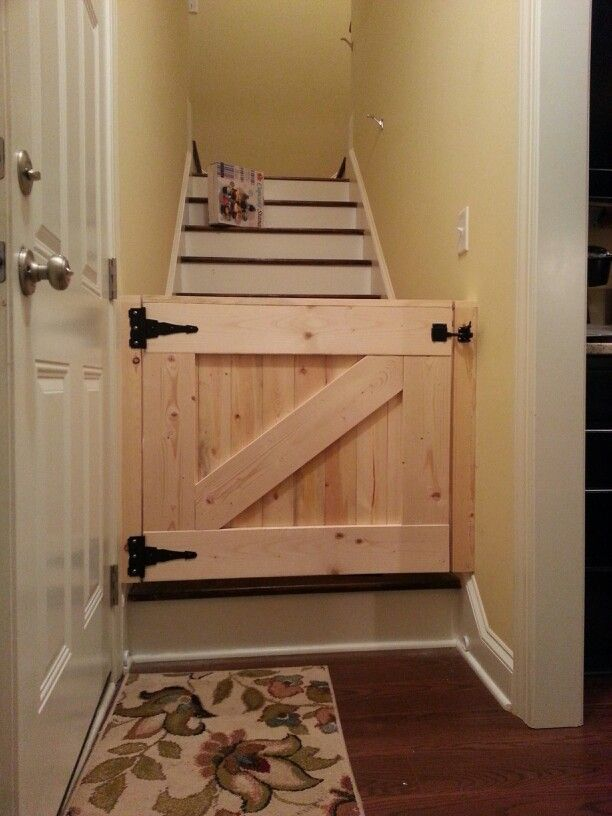 Bottom of the stairs idea?: Barn door baby gate!  So much nicer than the store-bought metal one that never really fit this space b/c of the moulding for the stairs.  Leaving it bare until I can decide on a paint color.