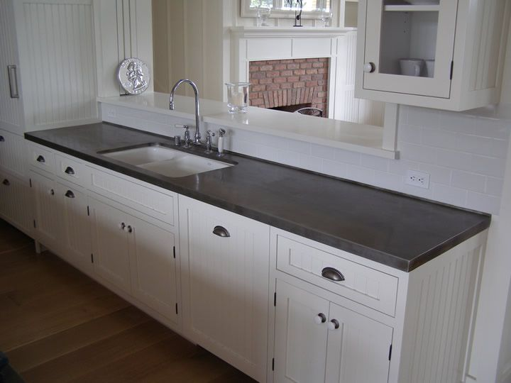 zinc countertops and white kitchen most likely combo with subway tile