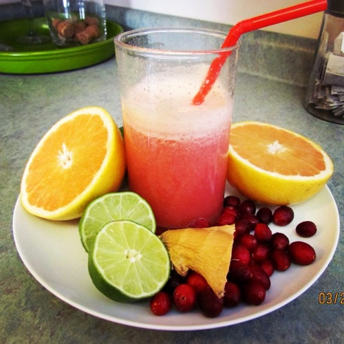 ... red grapefruit, 1 lime, 1 cup cranberries and a hunk of ginger