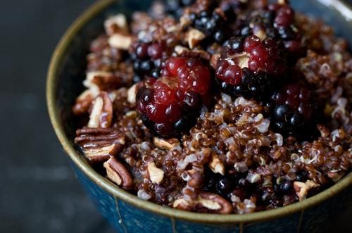 Warm cinnamon quinoa with berries and walnuts