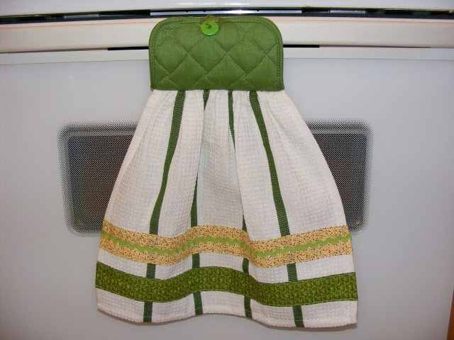 semi homemade kitchen towel gift has a pot holder on the top and with