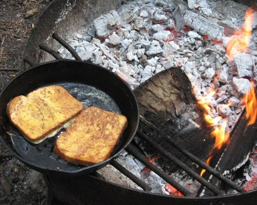 Campfire French Toast:   2 bread slices; 1 egg; 1/4 tsp cinnamon;     powdered sugar and maple syrup  Directions:  On the trail: Mix egg and cinnamon in bowl and cover bread with mixture. Place bread in frying pan over campfire or camp stove and fry until golden brown. Top with powdered sugar and maple syrup.