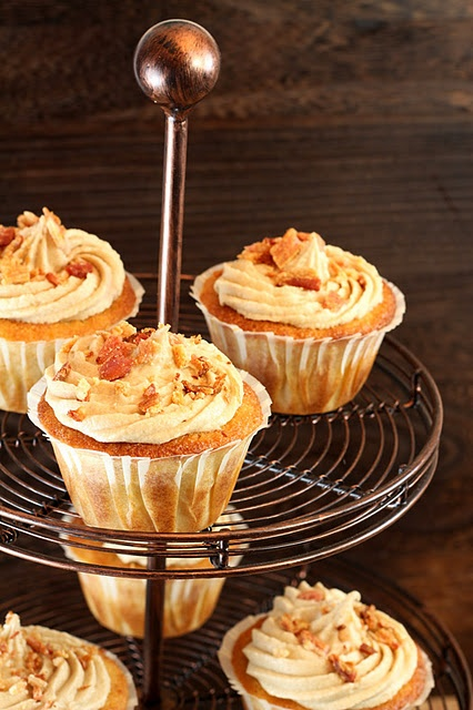 Maple Bacon Cornbread Cupcakes with Maple Frosting and Garnished with Bacon