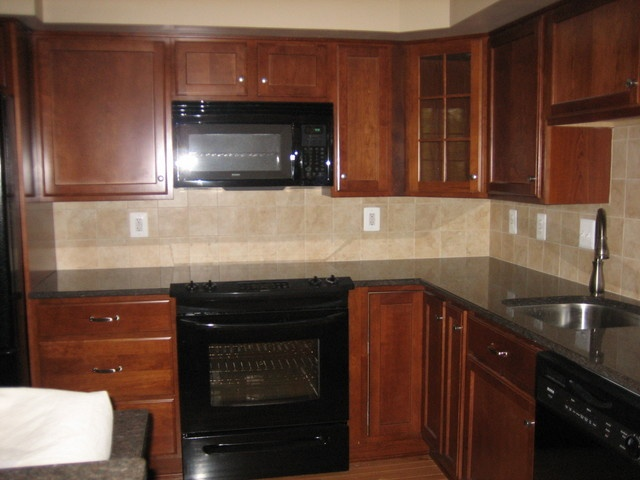 Cherry cabinets with black appliances for the home for Black cabinets and black appliances