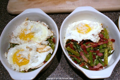 Savory parmesan asparagus topped with the yolk of a soft cooked egg ...