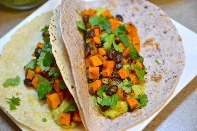 Chipotle sweet potato, black bean, and guacamole tacos