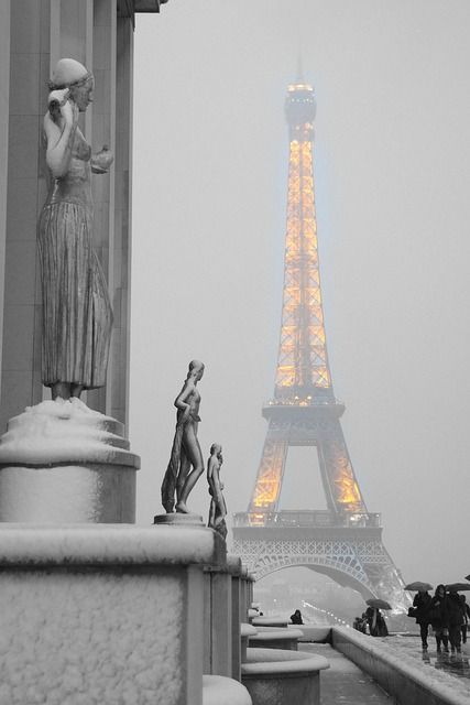 Eiffel Tower on a snowy day in Paris - Lovely image and so far unseen angle. I just love the color contrast, the orange lights of the tower are opening the photograph. Discovering The City of Lights by Christmas Discovering The City of Lights by Christmas a70f0283b1951a44bd3d189dfc270094