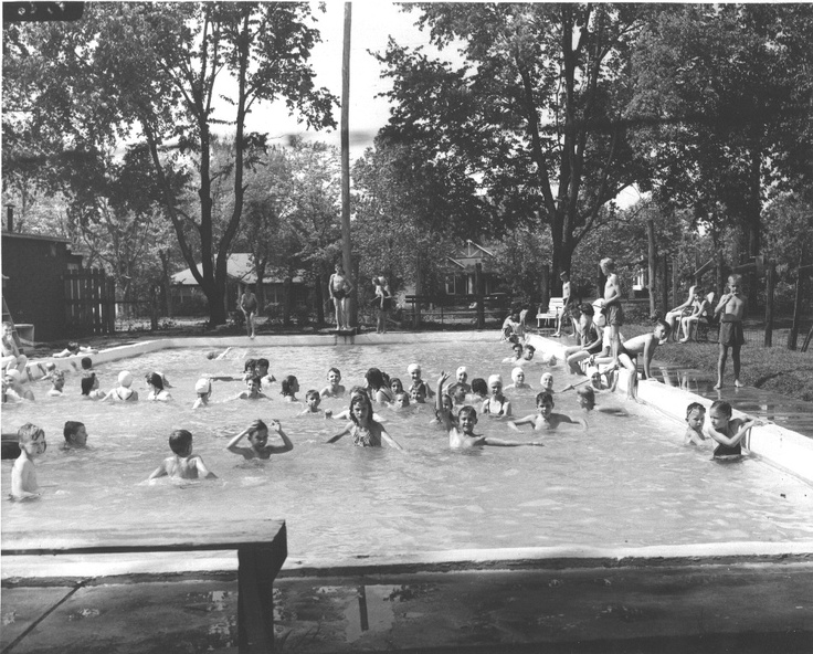 Children Playing In A Public Swimming Pool Near Oaklands Mansion