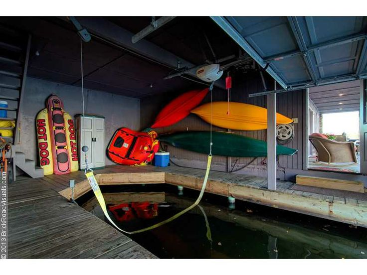 Garage door opened boat house storage pinterest for Boat storage garage
