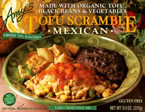 Organic tofu scrambled with vegetables and topped with salsa and ...