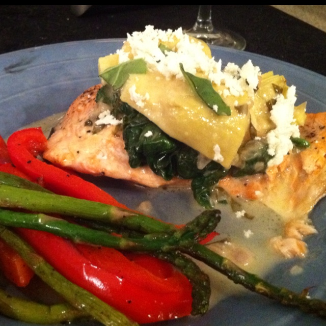 infused salmon cooked in parchment paper topped with sautéed spinach ...