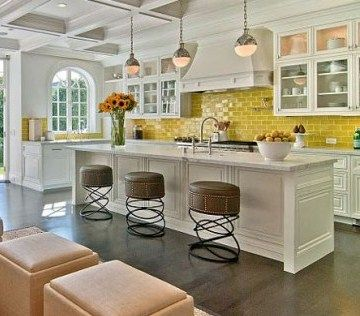 Yellow subway tile....crazy about the stools!