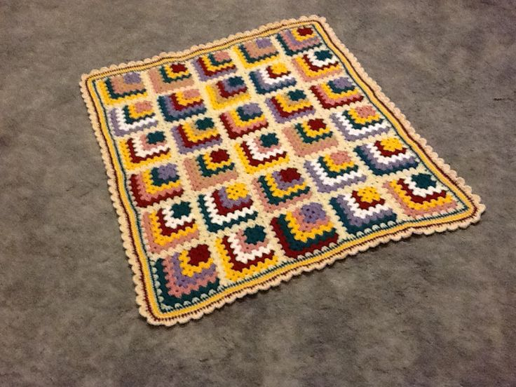 Mitre square crocheted knee rug