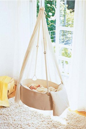 Hanging bassinet - wrap handled plastic or metal tub with fabric, use fabric (or fabric-wrapped chain) to hang. Add firm/flat pillow, mat, or cushion inside