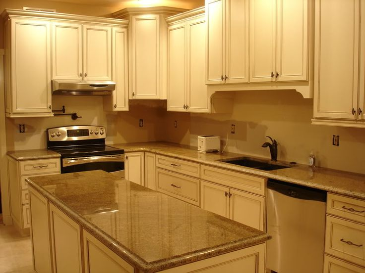 Cream cabinets with brown countertops plan kitchen for Cream kitchen cupboards