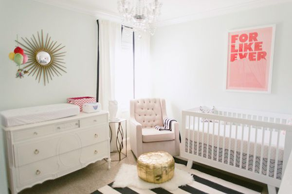 Minty green paint, chandelier lighting and @Martha Stewart Living gold accent mirror make this newborn's nursery a modern haven for both parents and infant.