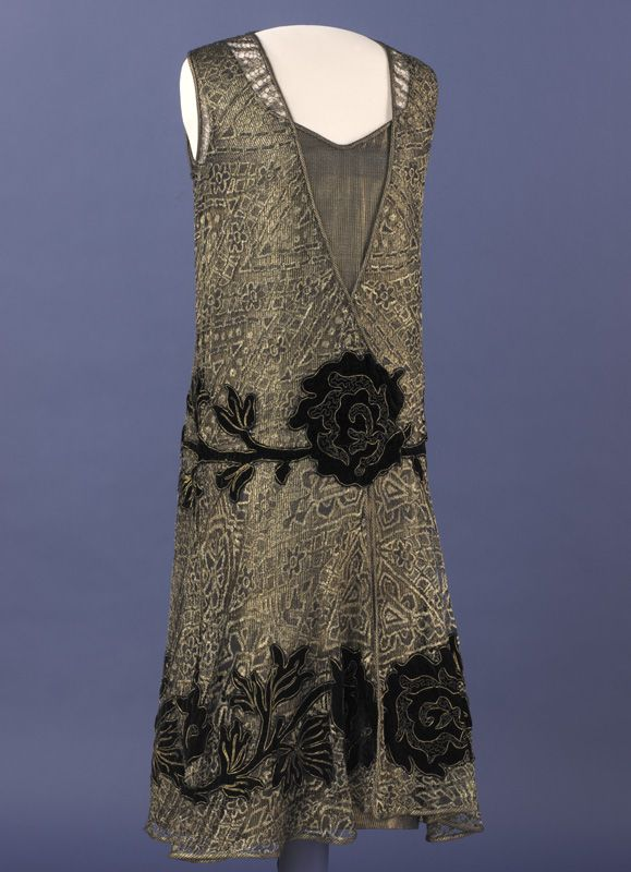 Grace Coolidge's Evening Dress. Grace Coolidge's flapper-style evening dress is made of velvet-trimmed black-and-gold metallic lace over a gold lamé underdress.