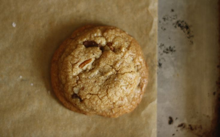 SALTED BROWN BUTTER PECAN CHOCOLATE CHIP COOKIES single cookie
