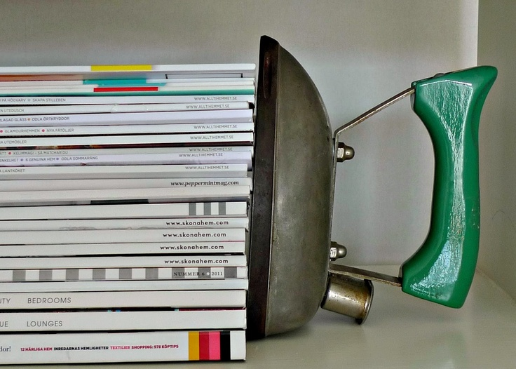 An old iron that has retired from its former duties finds new life as a bookend!