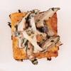 wild mushroom ragout on crispy polenta with comte cheese