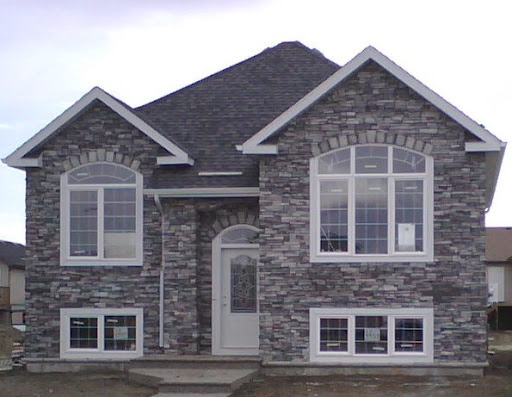 Stack stone house exterior house color pinterest for Stacked stone house