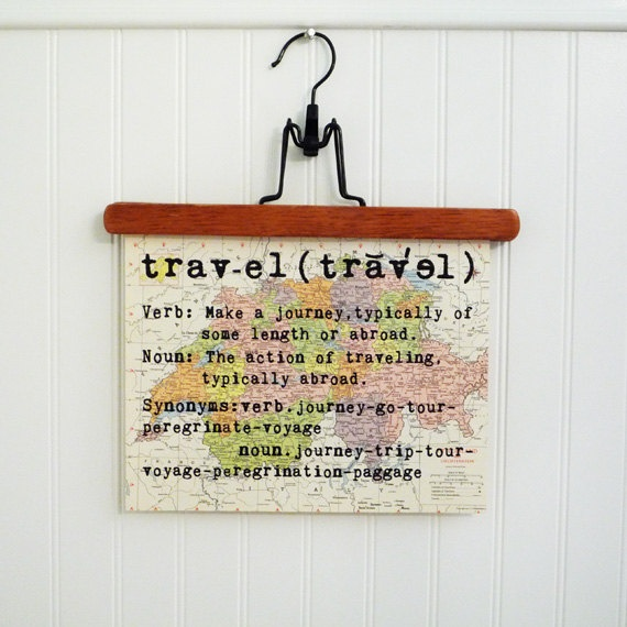 The Definition of 'Travel' printed on a world map.... Great Idea!