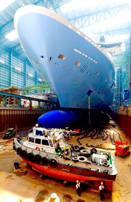 Quantum of the Seas getting ready to exit the building hall.